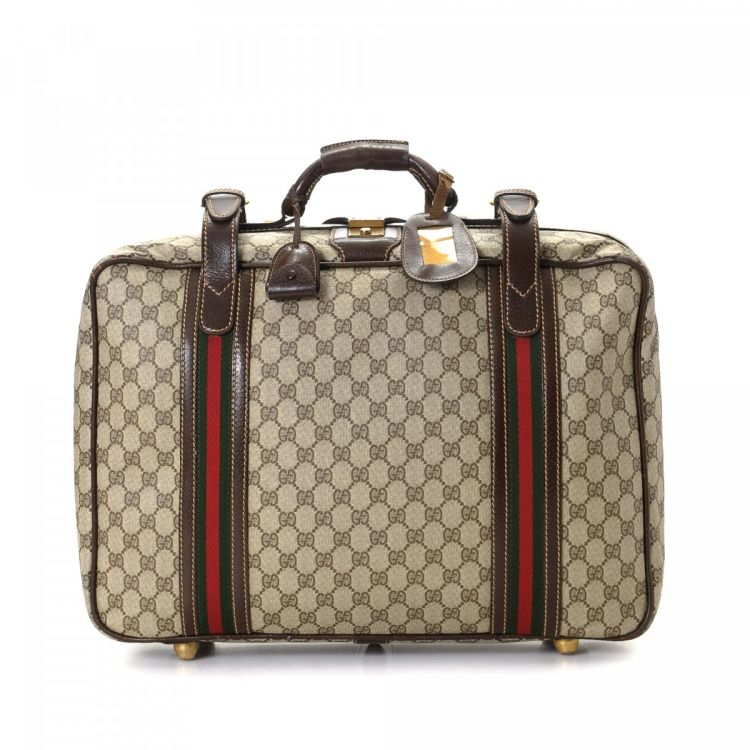 37b7533e6a5 The authenticity of this vintage Gucci Web travel bag is guaranteed by  LXRandCo. Crafted in gg supreme coated canvas