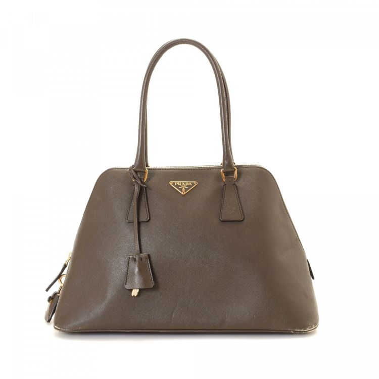 LXRandCo guarantees this is an authentic vintage Prada handbag. This  classic handbag was crafted in saffiano leather in taupe. Due to the vintage  nature of ... 501cb42e38b9a
