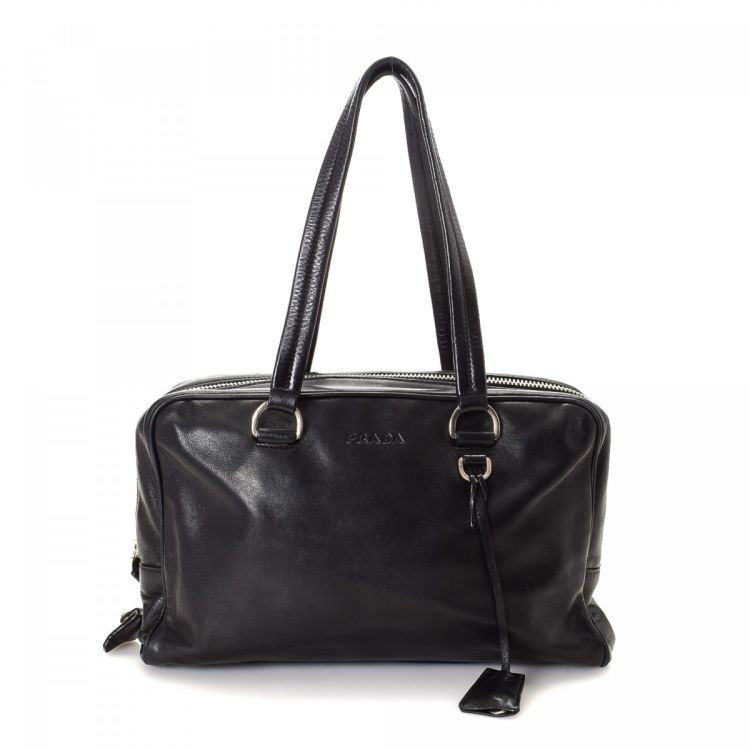 218020ae0695 LXRandCo guarantees this is an authentic vintage Prada handbag. This stylish  handbag was crafted in vitello leather in beautiful black.
