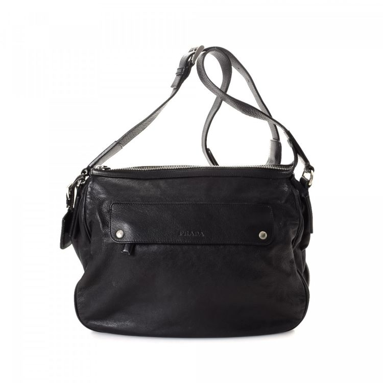 e879e3b0d17e ... authentic vintage Prada Messenger Bag messenger & crossbody bag. This  luxurious messenger & crossbody bag was crafted in vitello daino leather in  black.