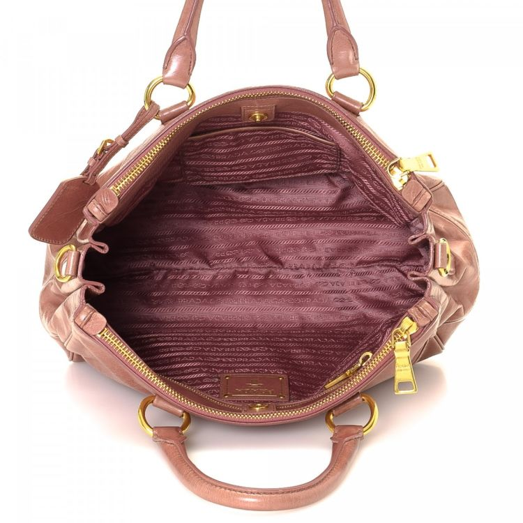 4415241614ea LXRandCo guarantees this is an authentic vintage Prada Two Way handbag.  Crafted in vitello shine leather, this stylish handbag comes in beautiful  pink.