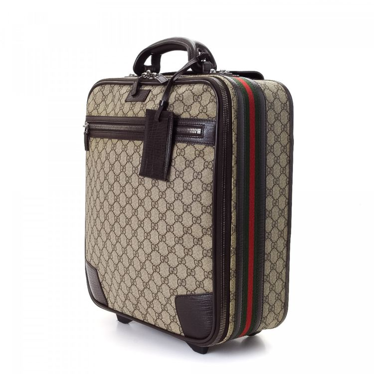 637698614c4 The authenticity of this vintage Gucci Web Suitcase trunk is guaranteed by  LXRandCo. Crafted in gg supreme coated canvas