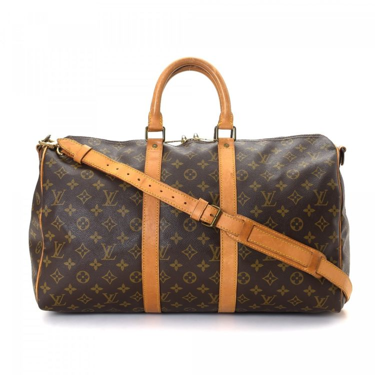 29ac285b8b6d LXRandCo guarantees this is an authentic vintage Louis Vuitton Keepall 45  Bandouliere travel bag. This elegant baggage was crafted in monogram coated  canvas ...