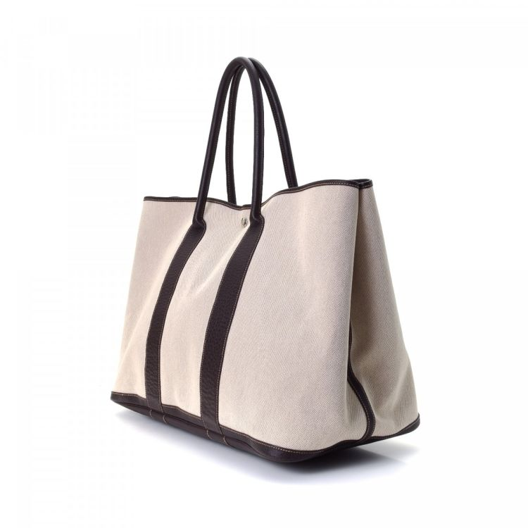 cccb792a356a The authenticity of this vintage Hermès Garden Party 50 tote is guaranteed  by LXRandCo. This everyday bag was crafted in canvas in beige.