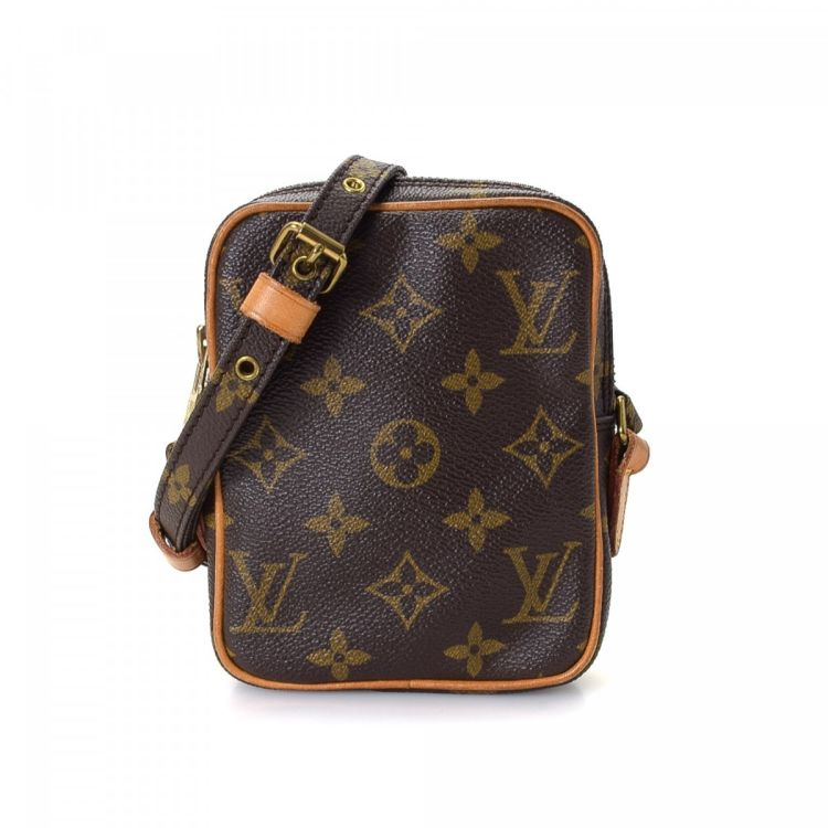 d8022dffed07 LXRandCo guarantees this is an authentic vintage Louis Vuitton Mini Danube  messenger   crossbody bag. This elegant pocketbook was crafted in monogram  coated ...