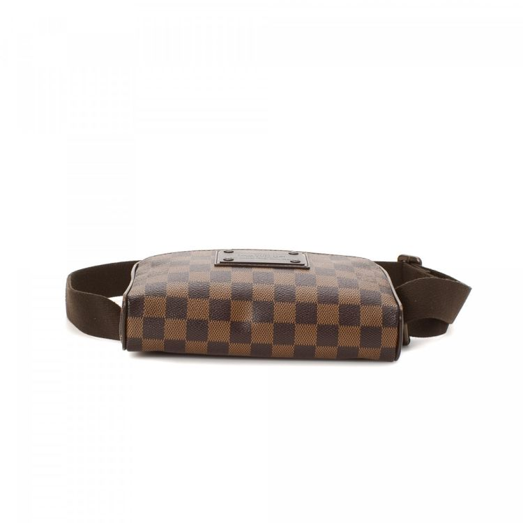 16d58cb3b79a LXRandCo guarantees the authenticity of this vintage Louis Vuitton Brooklyn  Bum Bag vanity case   pouch. This luxurious cosmetic case was crafted in  damier ...