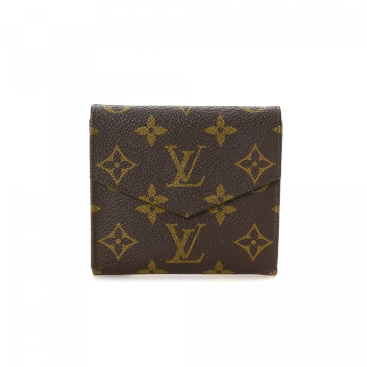396683c5b5e4 The authenticity of this vintage Louis Vuitton Elise Trifold wallet is  guaranteed by LXRandCo. Crafted in monogram coated canvas
