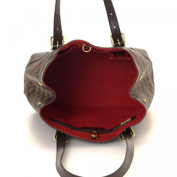6400a53d994 LXRandCo guarantees this is an authentic vintage Louis Vuitton Hampstead MM  shoulder bag. This chic purse in brown is made in damier ebene coated canvas .