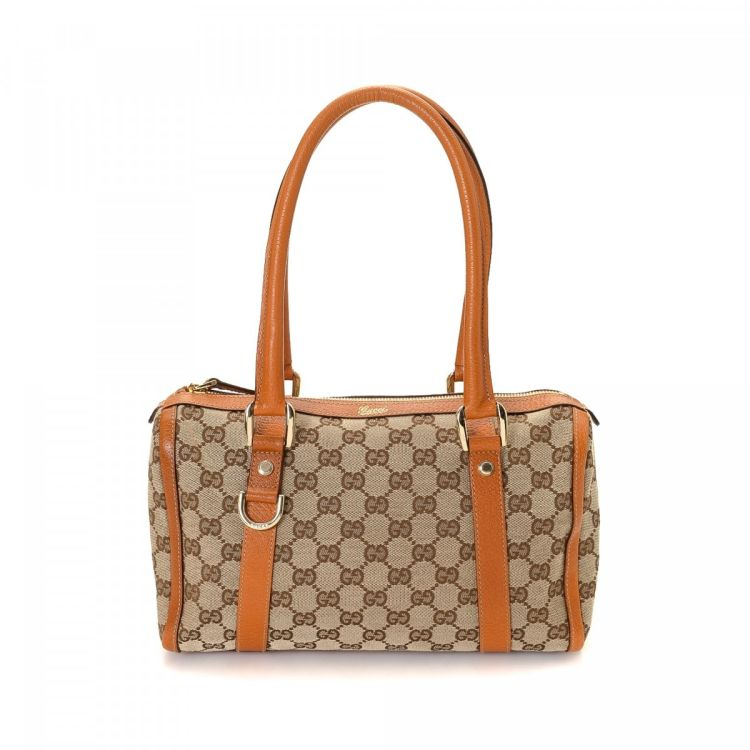 eef8d432eae The authenticity of this vintage Gucci D-Ring handbag is guaranteed by  LXRandCo. Crafted in gg canvas