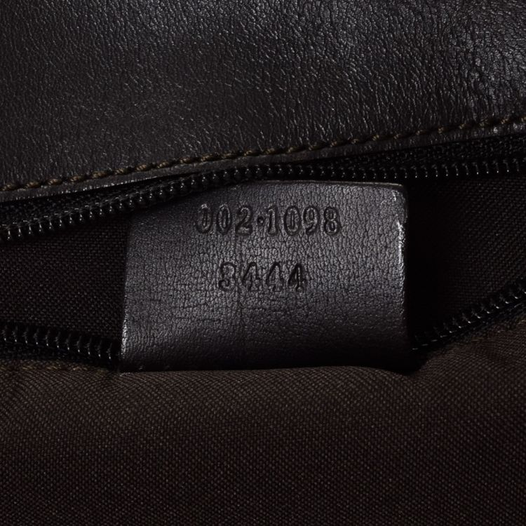 f2abe58002a LXRandCo guarantees this is an authentic vintage Gucci tote. Crafted in gg  canvas