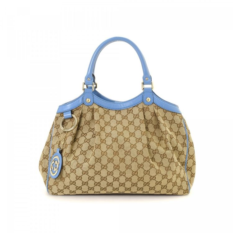 38ff350e29a6 The authenticity of this vintage Gucci Sukey handbag is guaranteed by  LXRandCo. This everyday handbag was crafted in gg canvas in beige. Due to the  vintage ...