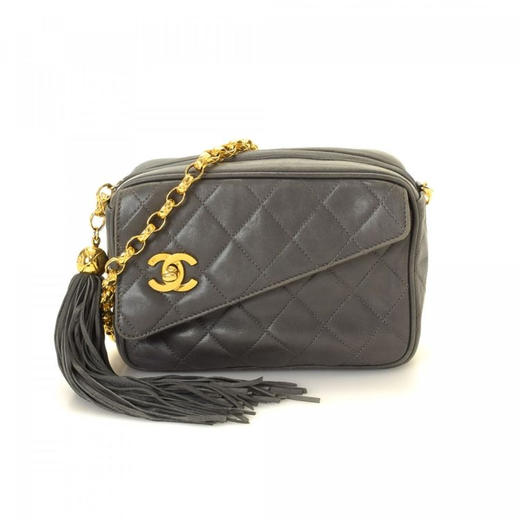 25ed83a949be LXRandCo guarantees this is an authentic vintage Chanel Small Tassel Camera  Bag shoulder bag. This chic bag was crafted in matelasse lambskin in grey.
