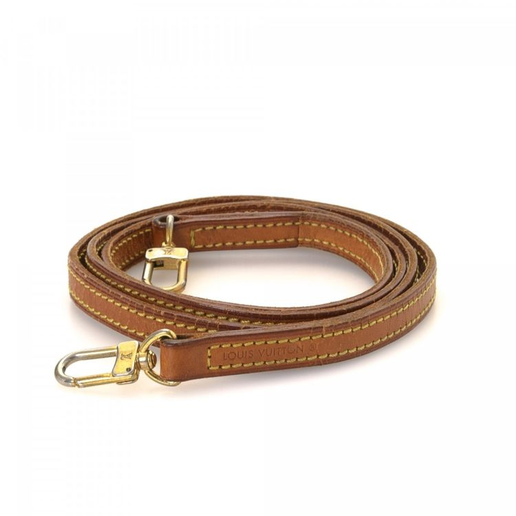 d658b41e3ff4 The authenticity of this vintage Louis Vuitton Shoulder strap is guaranteed  by LXRandCo. This refined strap in beautiful tan is made of leather.