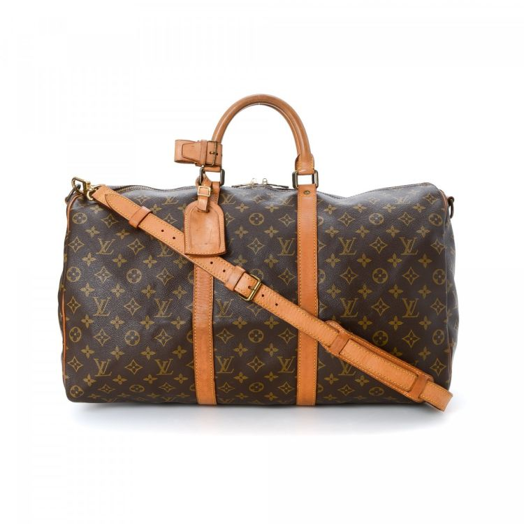 9105a60f799e ... of this vintage Louis Vuitton Keepall 50 Bandouliere travel bag.  Crafted in monogram coated canvas