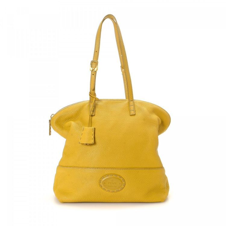 b1a90e9c6a The authenticity of this vintage Fendi shoulder bag is guaranteed by  LXRandCo. This signature shoulder bag in beautiful yellow is made in selleria  leather.