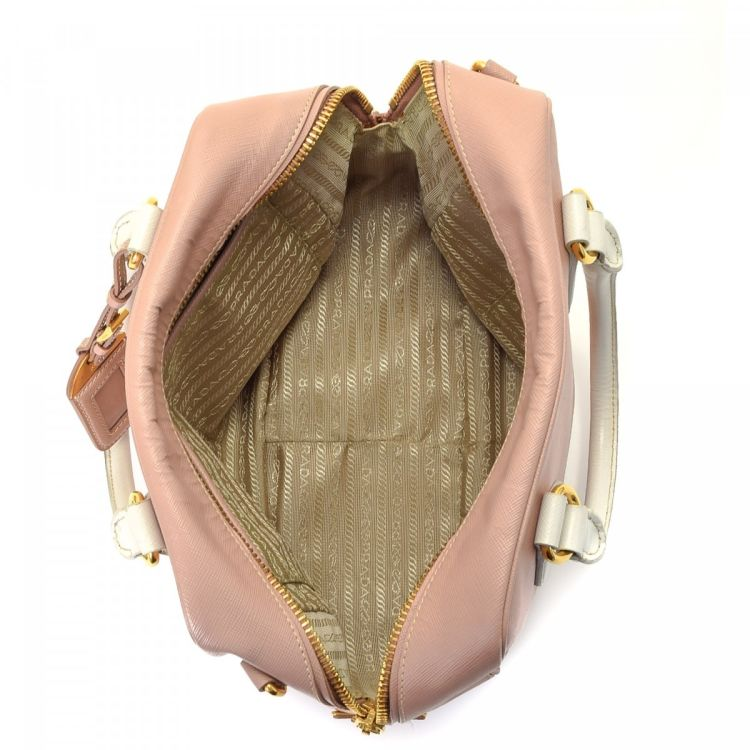 461a4f3c39cf ... netherlands lxrandco guarantees this is an authentic vintage prada box  handbag. crafted in saffiano cross