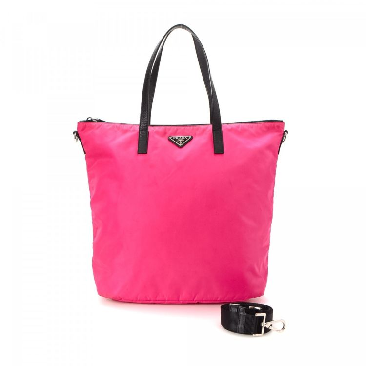 b2244ac5f7d3 LXRandCo guarantees the authenticity of this vintage Prada Two Way tote.  This luxurious tote in beautiful fuchsia is made in tessuto nylon.