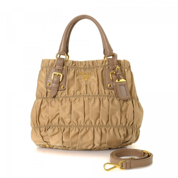 f96daf196a0c ... cheap the authenticity of this vintage prada tessuto two way handbag is  guaranteed by lxrandco.