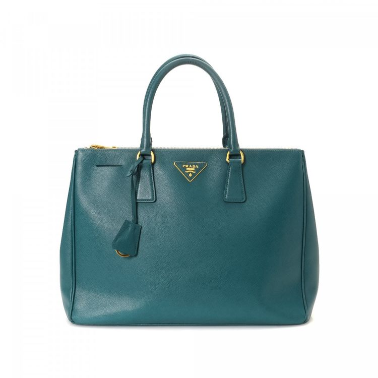 LXRandCo guarantees this is an authentic vintage Prada Galleria Bag handbag.  This chic pocketbook in beautiful teal is made in saffiano leather. 5e4272f322b03