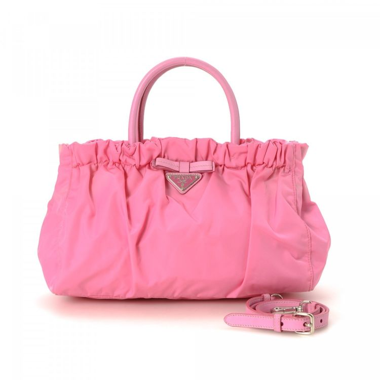 5e6662bab048 LXRandCo guarantees this is an authentic vintage Prada Gathered Two Way  handbag. This elegant bag in beautiful pink is made in tessuto nylon.