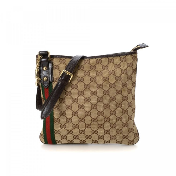 76bf4b1496bf17 The authenticity of this vintage Gucci Web Jolicoeur Crossbody Bag  messenger & crossbody bag is guaranteed by LXRandCo. Crafted in gg canvas,  this exquisite ...