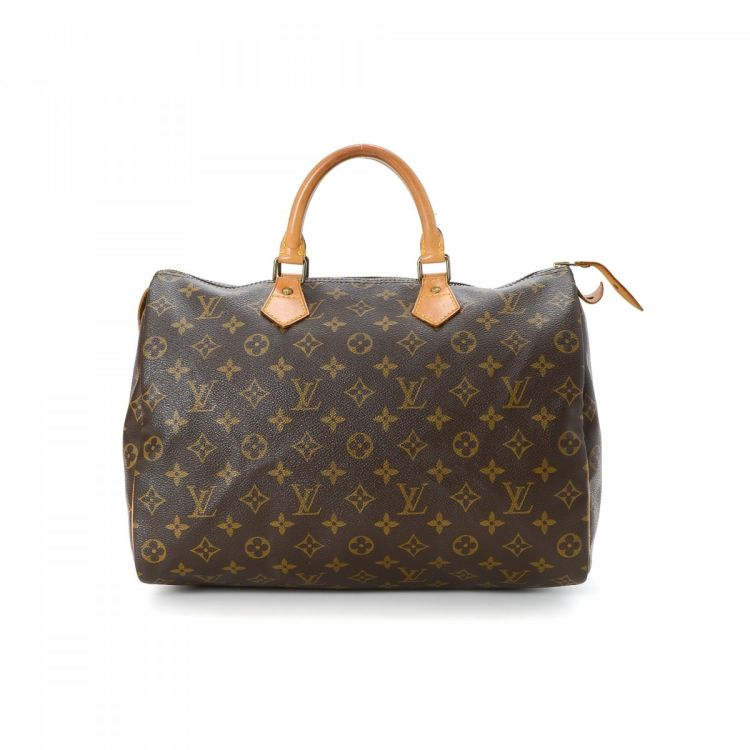 147d8bdadc39 LXRandCo guarantees this is an authentic vintage Louis Vuitton Speedy 35  handbag. This sophisticated purse was crafted in monogram coated canvas in  ...