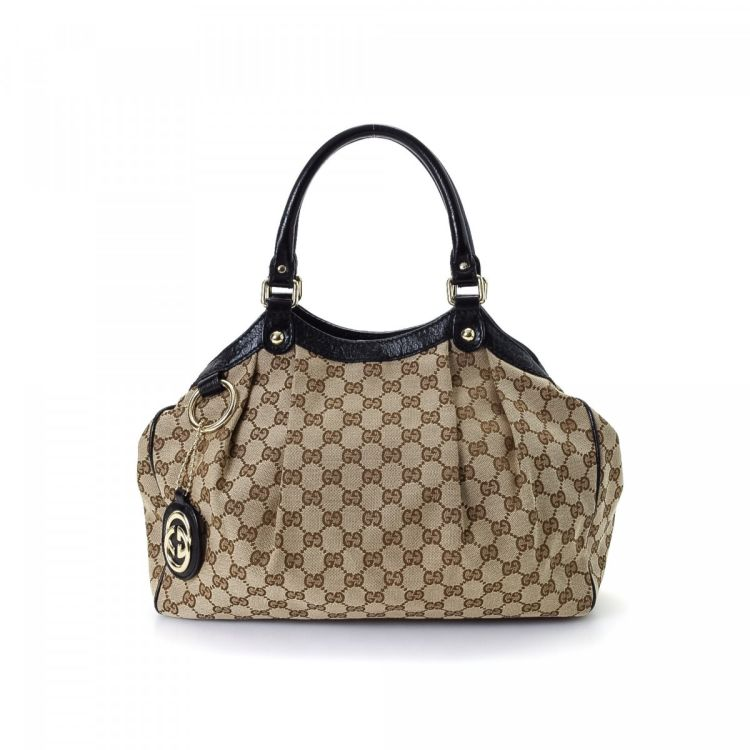 764cd9ea446d The authenticity of this vintage Gucci Sukey Bag tote is guaranteed by  LXRandCo. This practical tote bag was crafted in gg canvas in beige.