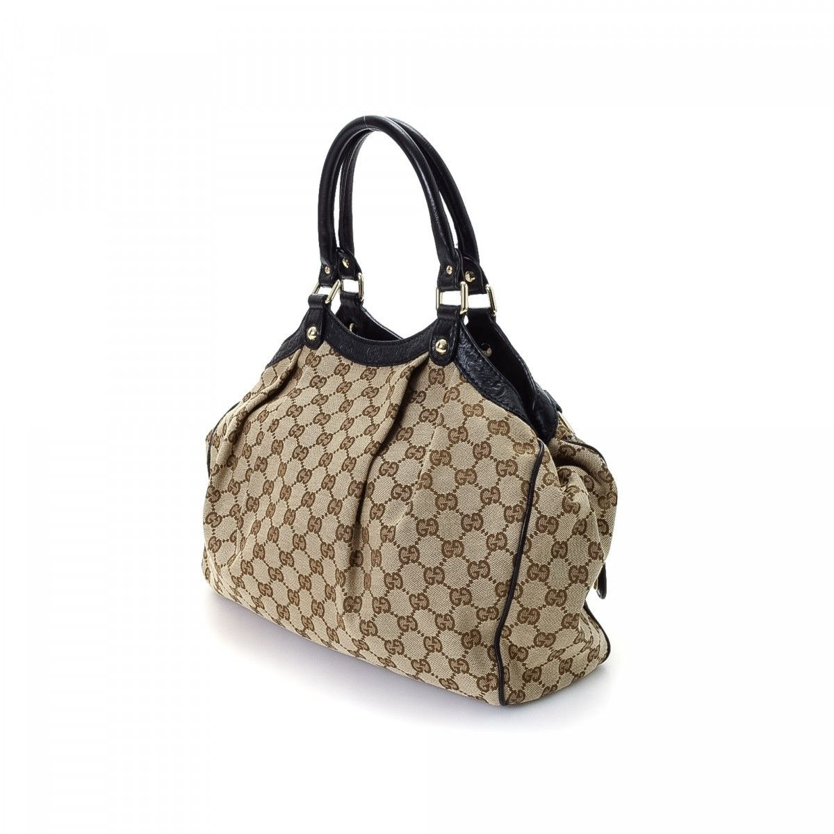 32dde2cf7de3 Gucci GG Canvas Sukey Tote Bag. The authenticity of this vintage Gucci  Sukey Bag tote is guaranteed by LXRandCo.