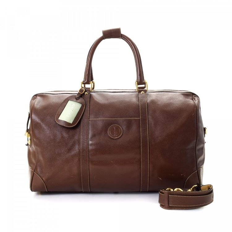 84a4bc6879d5 LXRandCo guarantees this is an authentic vintage Gucci travel bag. This  luxurious carry-on in beautiful brown is made of leather. Due to the vintage  nature ...