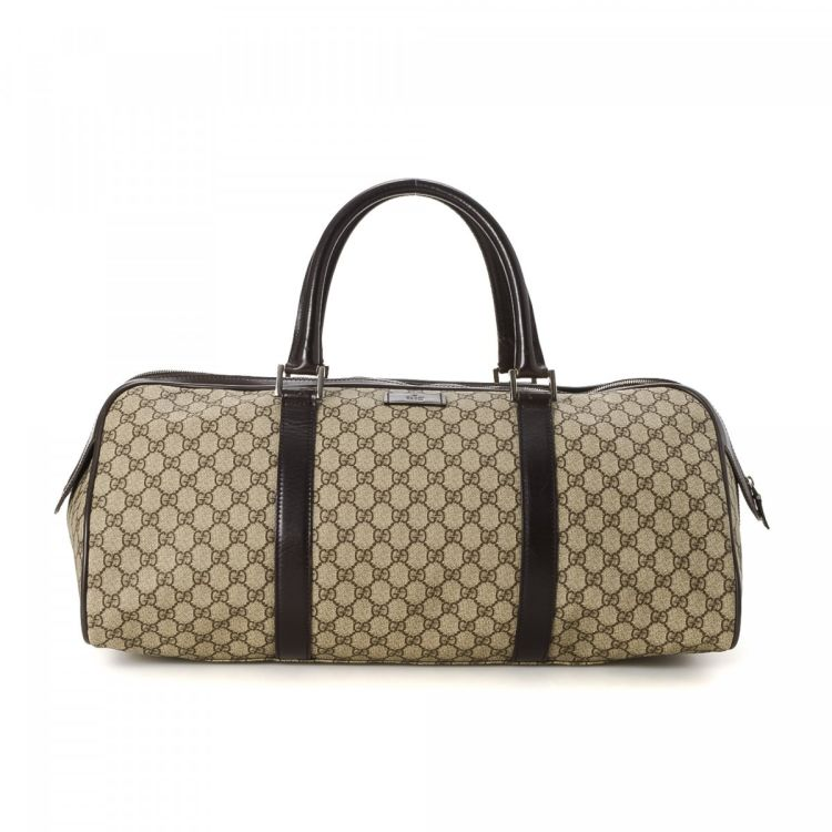 99c3bd344e2 LXRandCo guarantees the authenticity of this vintage Gucci Supreme travel  bag. Crafted in gg coated canvas