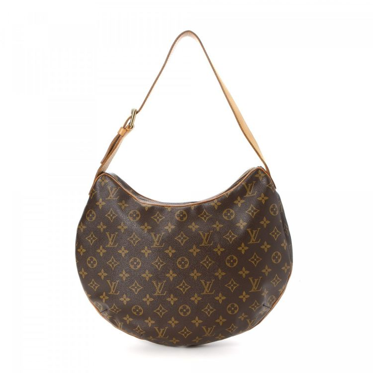 9087bf1e4fd7 LXRandCo guarantees the authenticity of this vintage Louis Vuitton  Croissant GM shoulder bag. This refined purse in brown is made in monogram  coated canvas.