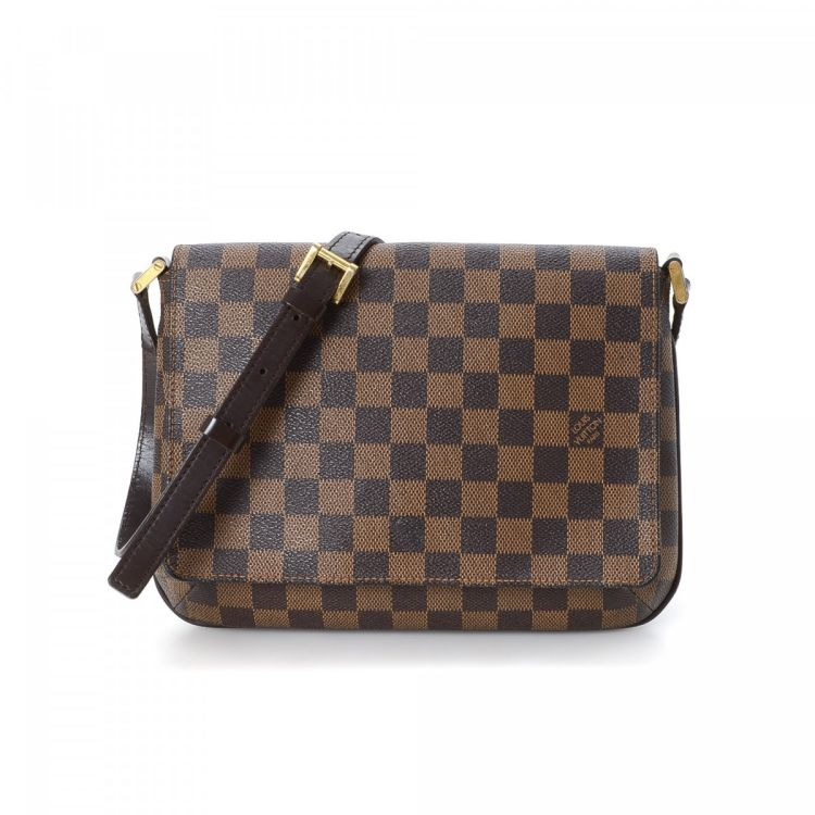cefcd418c444 ... Louis Vuitton Musette Tango Long Strap messenger   crossbody bag. This  iconic messenger   crossbody bag was crafted in damier ebene coated canvas  in ...