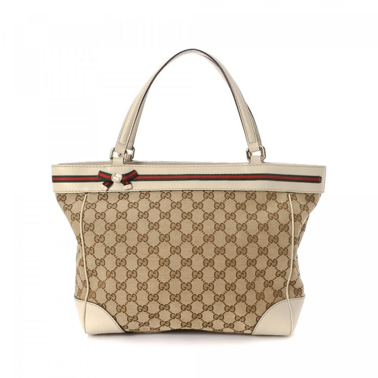 e170705a2a0 LXRandCo guarantees this is an authentic vintage Gucci Web Mayfair tote.  Crafted in gg canvas