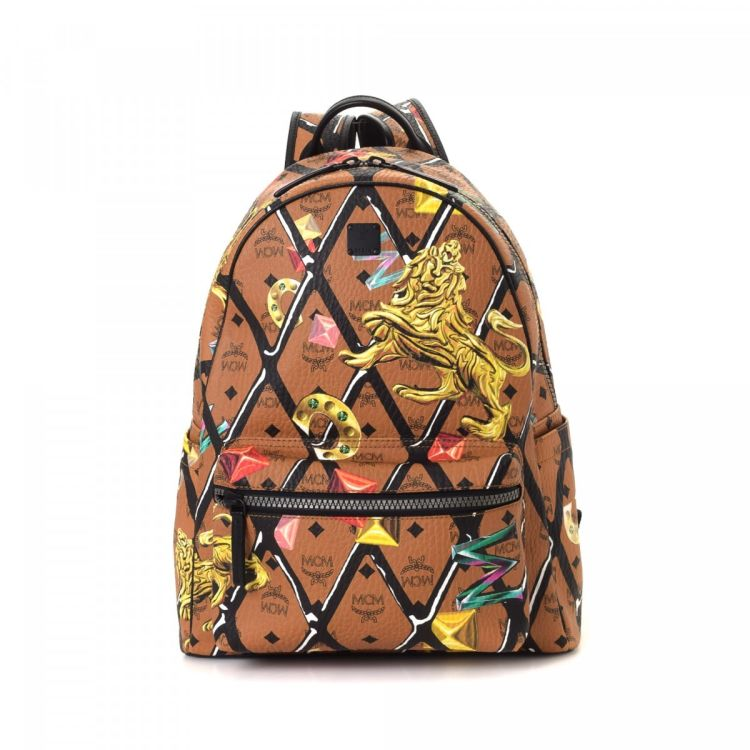0b669bccb8af The authenticity of this vintage MCM Lion backpack is guaranteed by LXRandCo.  This practical rucksack comes in multi color coated canvas.