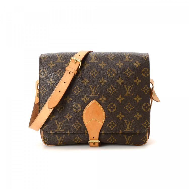 cfc3f233b2a5 LXRandCo guarantees this is an authentic vintage Louis Vuitton Cartouchiere  GM messenger   crossbody bag. Crafted in monogram coated canvas