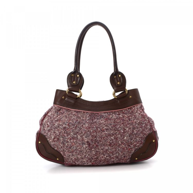 1d557559dc9a4 LXRandCo guarantees the authenticity of this vintage Céline shoulder bag.  Crafted in tweed wool