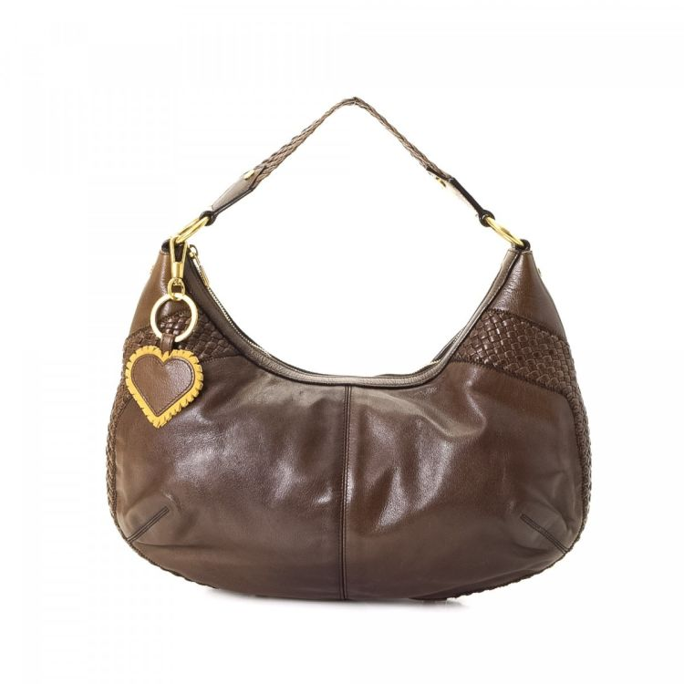 LXRandCo guarantees the authenticity of this vintage Yves Saint Laurent  Heart Charm shoulder bag. This signature shoulder bag was crafted in  leather in ... a0f2e0101e8db