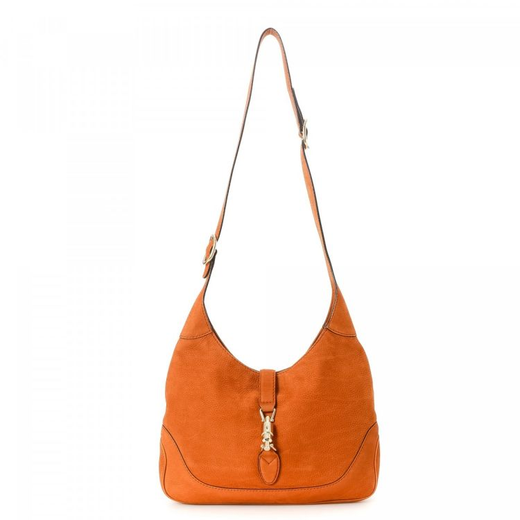 The authenticity of this vintage Gucci Jackie shoulder bag is guaranteed by  LXRandCo. This lovely purse comes in orange leather. Due to the vintage  nature ... dc10fbdc6b