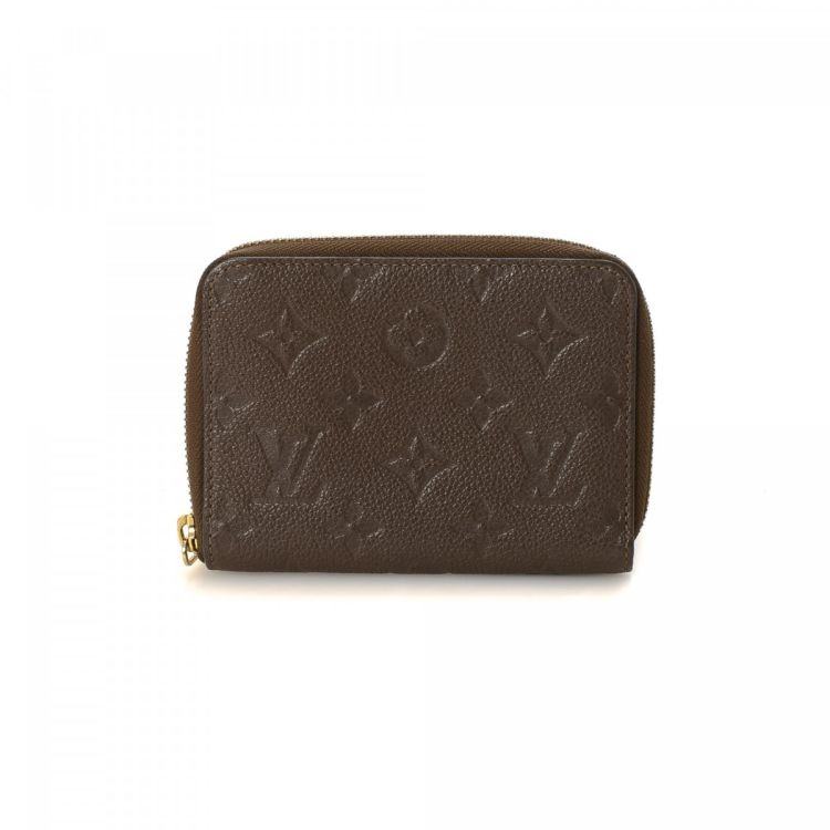 9601b51c1204 The authenticity of this vintage Louis Vuitton Zippy Coin Purse wallet is  guaranteed by LXRandCo. Crafted in monogram empreinte leather