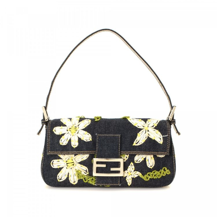 69b2c86b4c25 The authenticity of this vintage Fendi Embroidered Baguette shoulder bag is  guaranteed by LXRandCo. This lovely shoulder bag was crafted in denim in ...