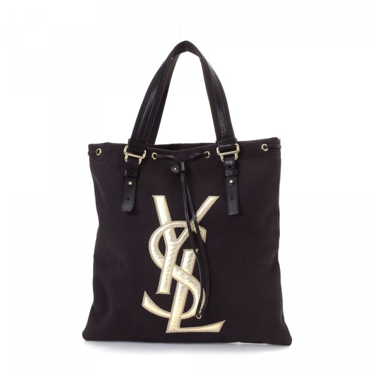0ee985bbeff9 LXRandCo guarantees this is an authentic vintage Yves Saint Laurent Bag tote.  This stylish large handbag was crafted in canvas in beautiful brown.