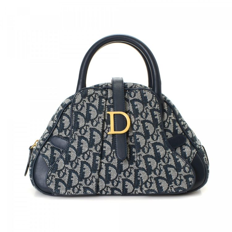 66ba23c03 LXRandCo guarantees the authenticity of this vintage Dior Mini Saddle Bag  handbag. This practical bag in blue is made in trotter canvas.