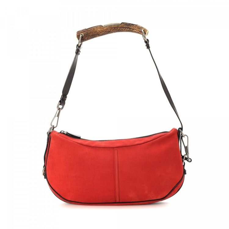 ea8edd0807 LXRandCo guarantees the authenticity of this vintage Yves Saint Laurent  Mombasa shoulder bag. This beautiful purse comes in red canvas.