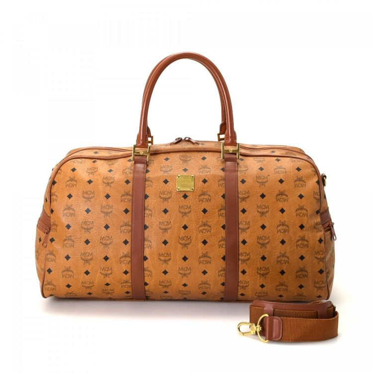 b5446a9b7 The authenticity of this vintage MCM travel bag is guaranteed by LXRandCo.  This lovely boston bag was crafted in visetos coated canvas in beautiful  cognac.