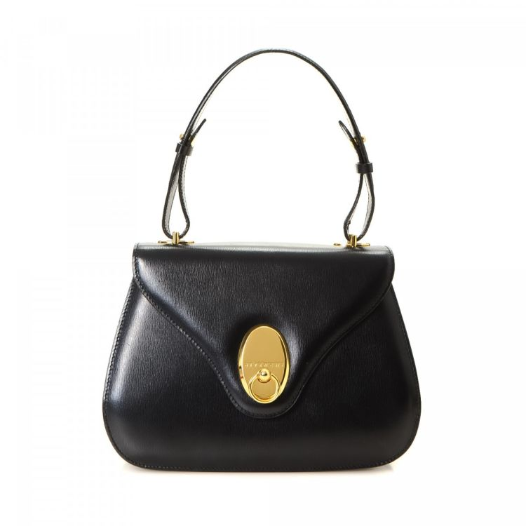2a4ec09f09 LXRandCo guarantees the authenticity of this vintage Givenchy handbag. This  beautiful purse was crafted in leather in black. Due to the vintage nature  of ...
