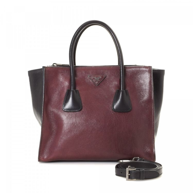 6f1435fd84 ... spain the authenticity of this vintage prada two way handbag is  guaranteed by lxrandco. crafted