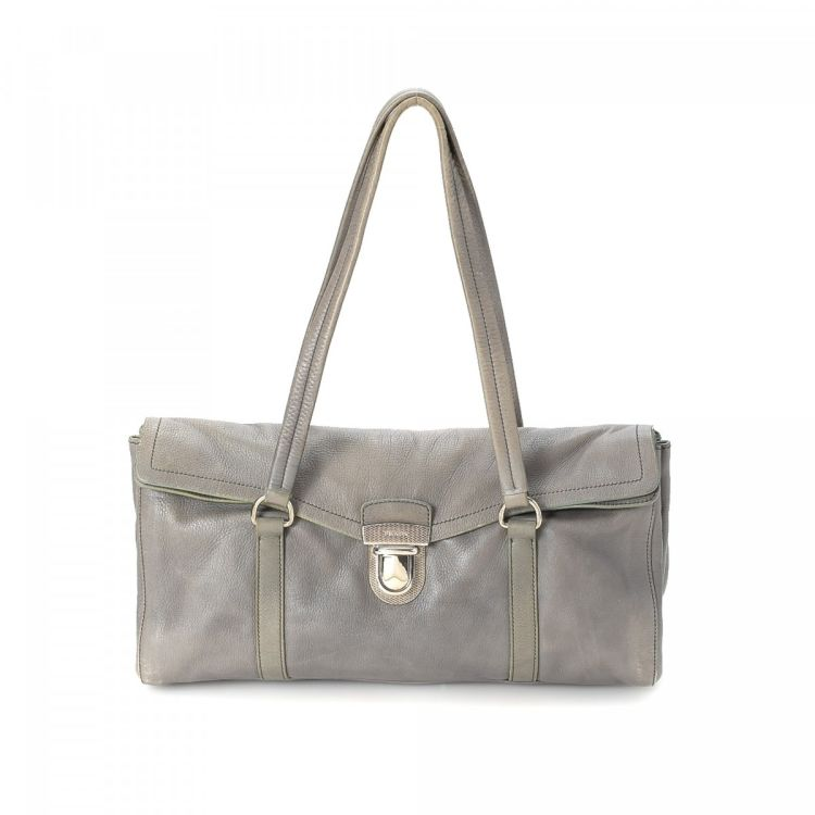 10d940f203 LXRandCo guarantees the authenticity of this vintage Prada shoulder bag.  This refined purse was crafted in leather in grey. Due to the vintage  nature of ...