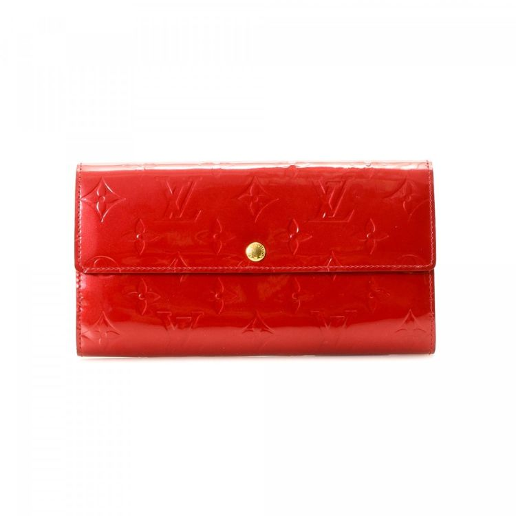 8632bdda9b7 LXRandCo guarantees this is an authentic vintage Louis Vuitton Sarah wallet.  This exquisite card holder in red is made in monogram vernis patent leather.