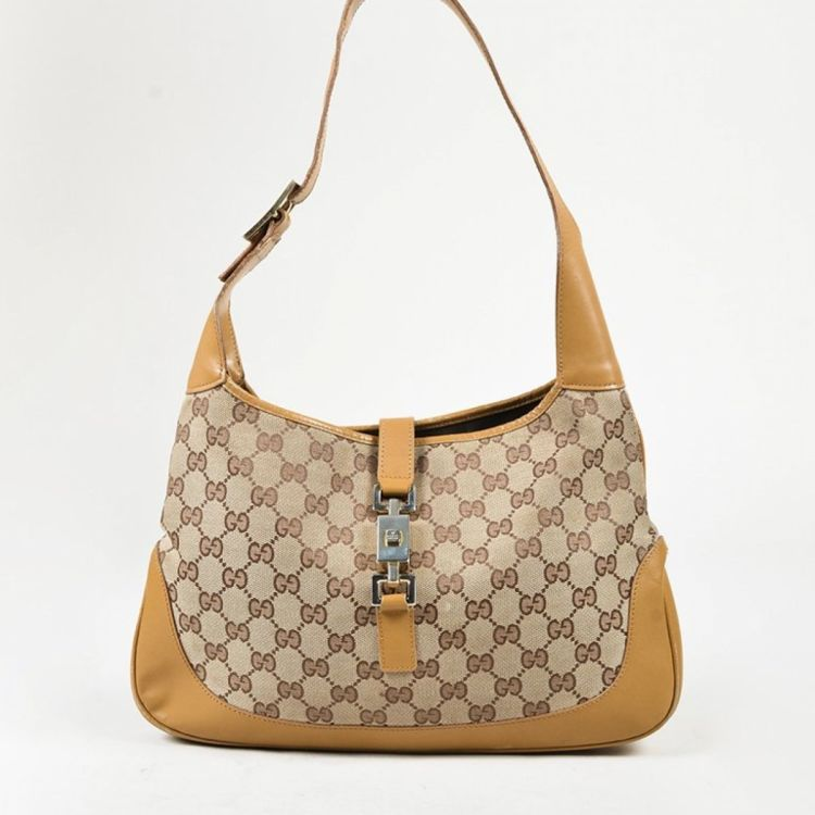2dc4549fb6a LXRandCo guarantees this is an authentic vintage Gucci Jackie shoulder bag.  Crafted in gg canvas