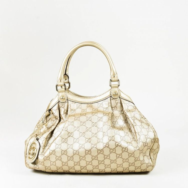 1ec9065678326a LXRandCo guarantees the authenticity of this vintage Gucci Sukey shoulder  bag. This stylish pocketbook was crafted in guccissima leather in beautiful  gold.